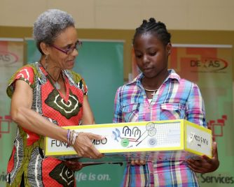 Celene Dillon receives a prize from Library assistant Althea Perkins. Dillon won second place in 9-12 year age group. Dillon read 63 books.