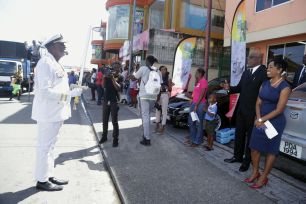 Chairman of the Tobago Festivals Commission George Leacock acts out his character as he salutes Chief Secretary Kelvin Charles and Secretary of Tourism, Culture and Transportation Nadine Stewart-Phillips who were watching the parade.