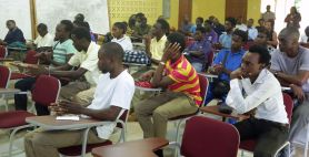 Participants listen keenly to information about the programme.
