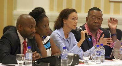 From left, Jason Arthur, Darelyn Smart, and Martin George,right, listen as Natalie Mohabir, second from right, shares a point during the meeting.