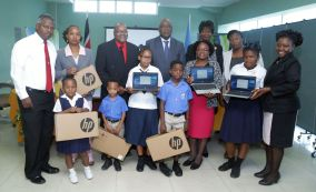 Chief Secretary Kelvin Charles, centre, takes a group photo with pupils of the Scarborough Methodist and Hope Anglican Primary schools, as well as (from left) programme facilitator Dr Victor Wheeler, teacher Isabelle Burris-Paul, Leon Yearwood, brother of Dr Brian Yearwood, Secretary of Health, Wellness and Family Development Dr Agatha Carrington, Administrator in the Division of Education, Innovation and Energy Jacqueline Job and Assistant Secretary in the Division of Education Marisha Osmond.