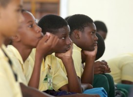 Pupils at the Signal Hill Secondary School listen to the discussion.