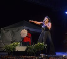 """Giselle Washington-Fraser sings for the first place position in the Windward Calypso competition with """"Plenty, Plenty Talk""""."""