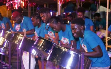 Our Boys focus on playing a sweet melody for spectators.