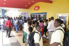 Students await watching the screening of Black Panther at MovieTowne Tobago.