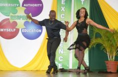 Teachers Xavier King and Keisha Clarke dance on stage, entertaining the crowd.
