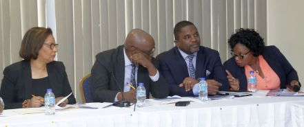 Deputy Permanent Secretary in the Ministry of National Security Florette Clarke, at right, talks to Chief Secretary Kelvin Charles, second from left, and Secretary of Finance and the Economy Joel Jack.