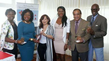 Celebrating the launch of Fashion Coda at the Magdalena Grand Beach Resort on Tuesday (March 6, 2018) from left are Roxanne Colthrust, managing director of Destination T&T, Secretary of Community Development, Enterprise Development and Labour Marslyn Melville-Jack, Natalie Ayin of cocktail brand sponsor Captain's Brew Rum Punch, fashion coordinator Antineil Blackman, Magdalena Manager Vinod Bajaj and Fashion Coda organiser Don Grant.