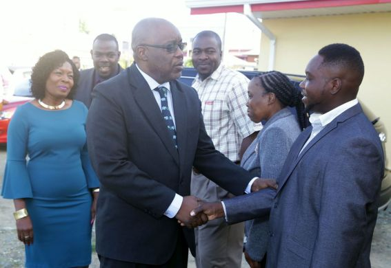 Chief Secretary Kelvin Charles greets president of the Canaan/Bon Accord village council Wade David on his arrival at the commissioning ceremony of the Canaan/Bon Accord Multipurpose Facility on Tuesday (March 6, 2018). Looking on from left are Secretary of Community Development, Enterprise Development and Labour Marsyln Melville-Jack, the Division's Assistant Secretary Shomari Hector, area representative Clarence Jacob and Administrator in the Division Cherryl Ann Solomon.