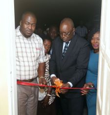 Chief Secretary Kelvin Charles cuts the ribbon to officially open the facility at Canaan/Bon Accord. With him from left are area representative Clarence Jacob, former area representative Dolores Edwards, president of the village council Wade David and Secretary of Community Development, Enterprise Development and Labour, Marslyn Melville-Jack.