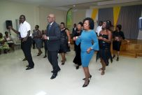Chief Secretary Kelvin Charles and Secretary of Community Development, Enterprise Development and Labour Marslyn Melville-Jack dance the electric slide along with members of the C&B ballroom dancers following the commissioning of the Canaan/Bon Accord Multipurpose Facility.