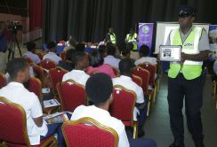 Police Constable Rendell Thomas shows the image captured by the speed guns to the audience.