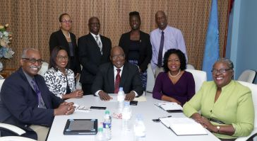 Seated in front row from left are CCLCS Director Andre Henry, Chairman Dr Marlene Attzs, Chief Secretary Kelvin Charles, Secretary of the Division of Community Development, Enterprise Development and Labour Marslyn Melville-Jack and Technical Advisor in the Division of Education, Innovation and Energy Dr Verleen Bobb-Lewis. Back row from left are Division of Co-operatives Development, Ministry of Labour and Small Enterprise Development representative Andrea Marcano-Quilden, Ministry of Education representative Anderson Thorington, Tobago Campus manager Simone Mitchell and Governor Christopher Auguste.