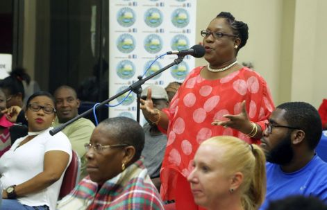 Community member Marjorie Moore-Carrington addresses the head table as she makes a contribution.
