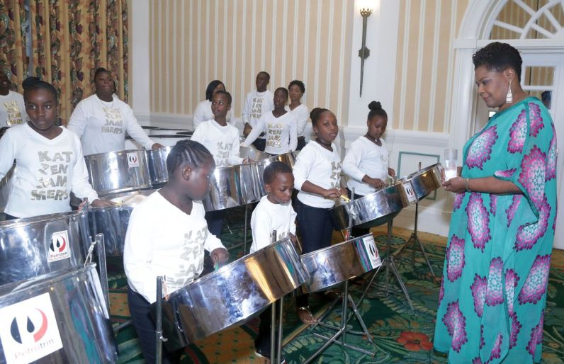 Young Petrotrin Katenjamemrs play on their steelpans for Trinidad and Tobago President, Her Excellency Paula-Mae Weekes.