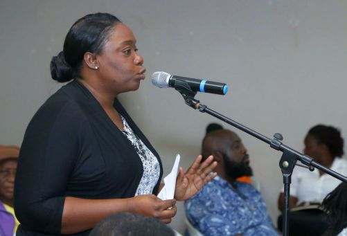 Asha James shares her concerns with the those in attendance at the meeting.
