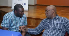 Signal Hill Government primary school teacher Steve Peterkin chats with Chief Secretary Kelvin Charles after the meeting.