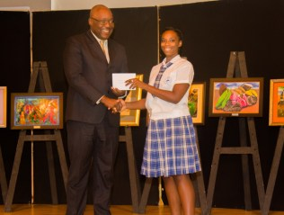 Shanice Ward of Goodwood Secondary School receives her prize from Chief Secretary Kelvin Charles.