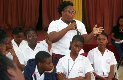 Students participate in the discussion.