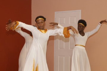 Dancers perform during the official programme.