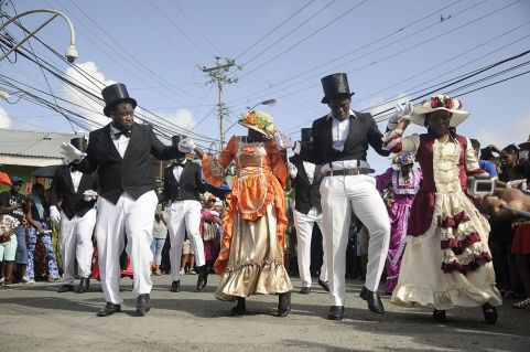 The wedding party dance and have a good time during the Ole Time Wedding in Moriah. They showed off some steps such as the brush back and the jig. The Ole Time Wedding is one of several community events at the Tobago Heritage Festival.