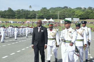 Chief Secretary Kelvin Charles arrives at the 2018 Tobago Independence Parade and is escorted by Lieutenant Colonel Peter Ganesh. Behind Charles is Brigadier General Archilus Phillips.