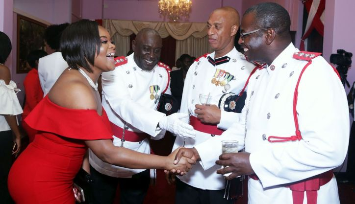 At the reception following the parade Sports Minister Shamfa Cudjoe greets, from right, ADFO Marlon Charles, ACFO Clebert Grayson and ADFO Garth Jacob who introduces his colleagues.