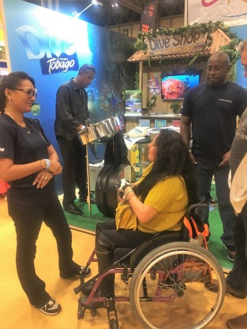 A visitor to the Dive Show interact with Tobago reps. She will be visiting Tobago in the next few weeks to dive.