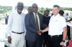 THA Chief Secretary Kelvin Charles, centre, NIDCO Chairman Herbert George and Captain Timuras Maravskij.