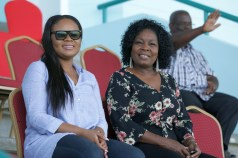 Minister of Sport and Youth Affairs and Tobago West MP Shamfa Cudjoe, left, takes in the Falcon Games action alongside Secretary of Community Development, Enterprise Development and labour Marslyn Melville-Jack.