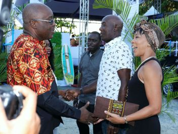 Chief Secretary Kelvin Charles, left, and Secretary of Tourism, Culture and Transportation Nadine Stewart-Phillips, second from left, greet Prime Minister Dr. Keith Rowley and his wife Sharon Rowley, right, during the show.