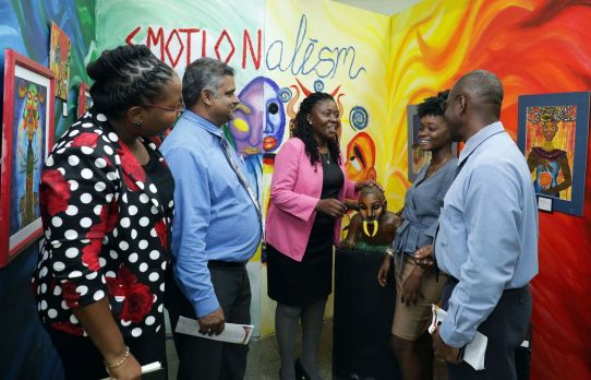 Assistant Secretary in the Office of the Chief Secretary Marisha Osmond, centre, admires a sculpture during the exhibition. Also in photo, from left, are Signal Hill art teacher Jenielle Carrington, Ministry of Education visual arts curriculum officer Reynold Ramlogan, exhibitor Shayana Daniel—who created the piece—and acting Signal Hill principal Xavier King.