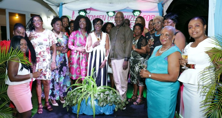 Chief Secretary Kelvin Charles and his wife, Catherine Anthony-Charles, take a group photo with attendees.