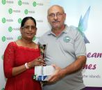 Seema Sookdeo receives the trophy and prizes for Johanson Singh from tournament organiser Jeffrey Azar. Singh made a hole in one on Hole No 7 on the first day of the tournament.