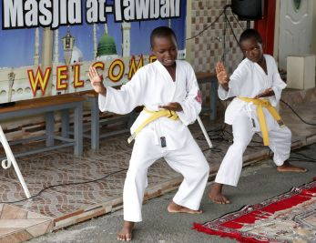 A karate display by Adam and Malik Baker is presented to attendees.