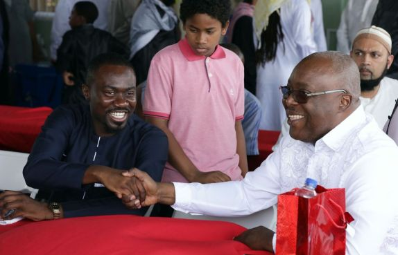 Chief Secretary Kelvin Charles and Minority Councillor Farley Augustine greet each other at the celebrations.