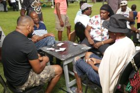 Here, attendees play a game of cards.