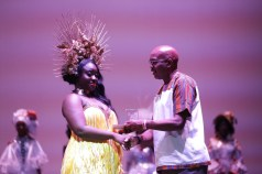 1st runner-up, Nalia Taitt, representing the Buccoo Academy of Performing Arts, receives her award from First Citizens' Manager of Retail Banking, Kurt Headley.