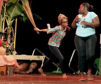 Valerie (Kelliesha Douglas) indulges in a ritual with Doodoo (Kenya Patrick) as her friend Kathy hides.