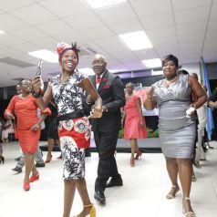 THA Chief Secretary Hon. Kelvin Charles joins others on the floor for the electric slide .