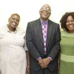 At the Scarborough R.C. Primary School, THA Chief Secretary Hon. Kelvin Charles (C) shares a light moment with Acting Vice Principal Mary Rogers (L) and Acting Principal Patricia Wafe.