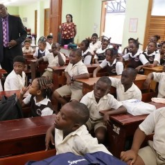THA Chief Secretary Hon. Kelvin Charles is amongst pupils of the Scarborough R.C. Primary School.