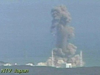 smoke ascends from the Fukushima Dai-ichi nuclear