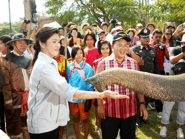 Thailand's Primer minister Yingluck Shinawatra is greeted by an elephant