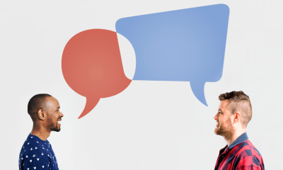 Two people with speech bubbles above their heads