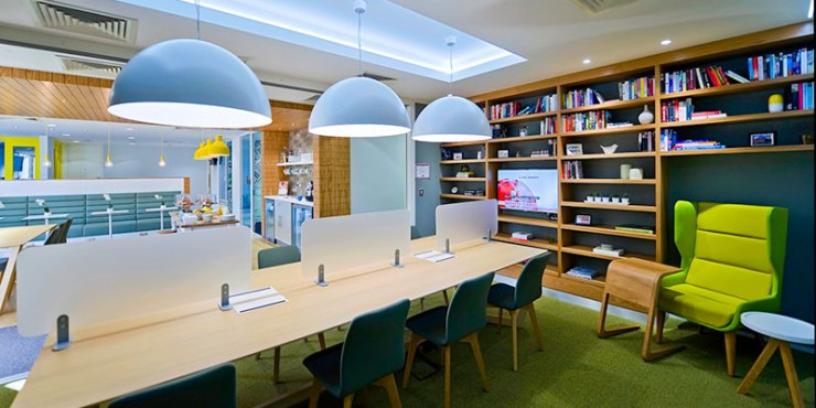 A Regus building with a desk and chair in a library