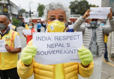 Activists affiliated with 'Human Rights and Peace Society Nepal' protest near the Indian Embassy in Kathmandu against the alleged encroachment of the Nepal border by India, 12 May 2020 (Photo: Reuters/Navesh Chitrakar).