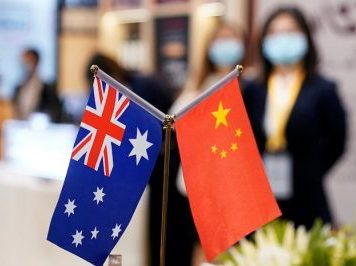 Australian and Chinese flags are seen at the third China International Import Expo (CIIE) in Shanghai, China 6 November, 2020 (Photo: Reuters/Aly Song).