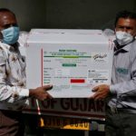 Officials unload boxes containing vials of AstraZeneca's COVISHIELD, a coronavirus disease (COVID-19) vaccine manufactured by Serum Institute of India, outside a vaccination storage centre in Ahmedabad, India, 12 January 2021 (Photo: Reuters/Amit Dave).