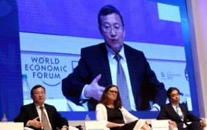 China's Vice Minister of Commerce Wang Shouwen speaks next to European Commissioner for Trade Malmstrom and Japan's Vice Minister of International Affairs METI during the Business Forum at the 11th WTO's ministerial conference in Buenos Aires, Argentina, 12 December 2017 (Photo: Reuters/Marcos Brindicci).